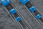 High Voltage Radial Leaded Capacitors - Johanson Dielectrics